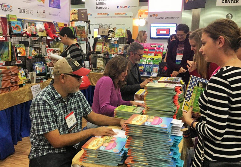 Book signing at the booth