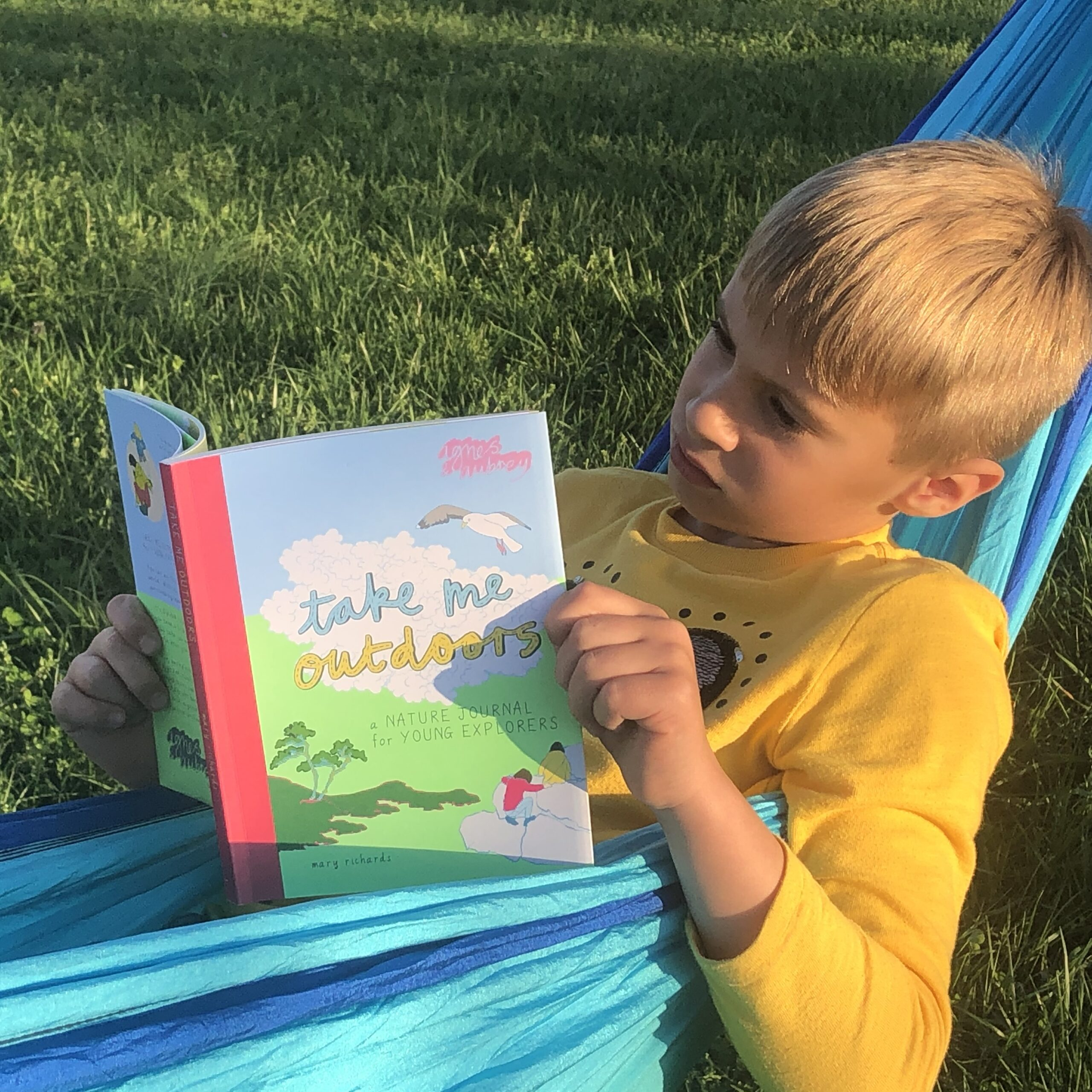 boy-reading-in-hammock